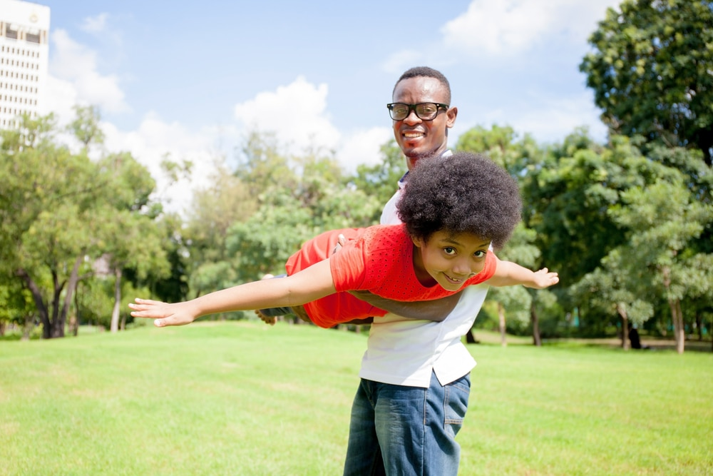 man playing with boy