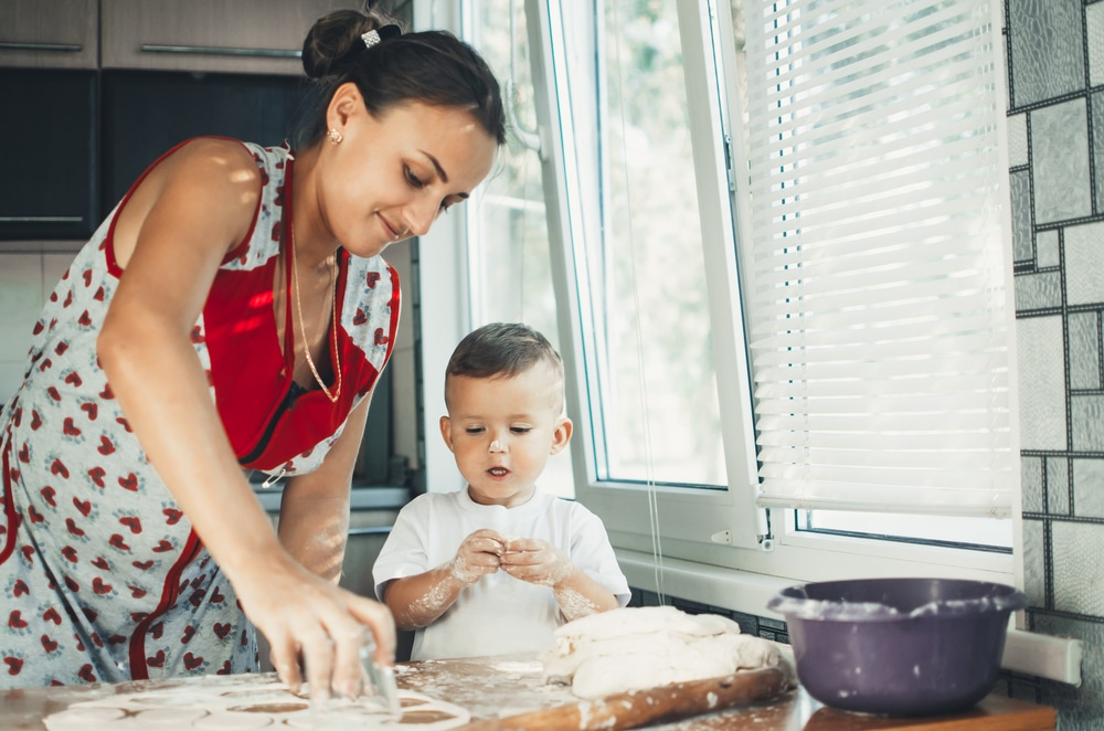 woman and boy cooking