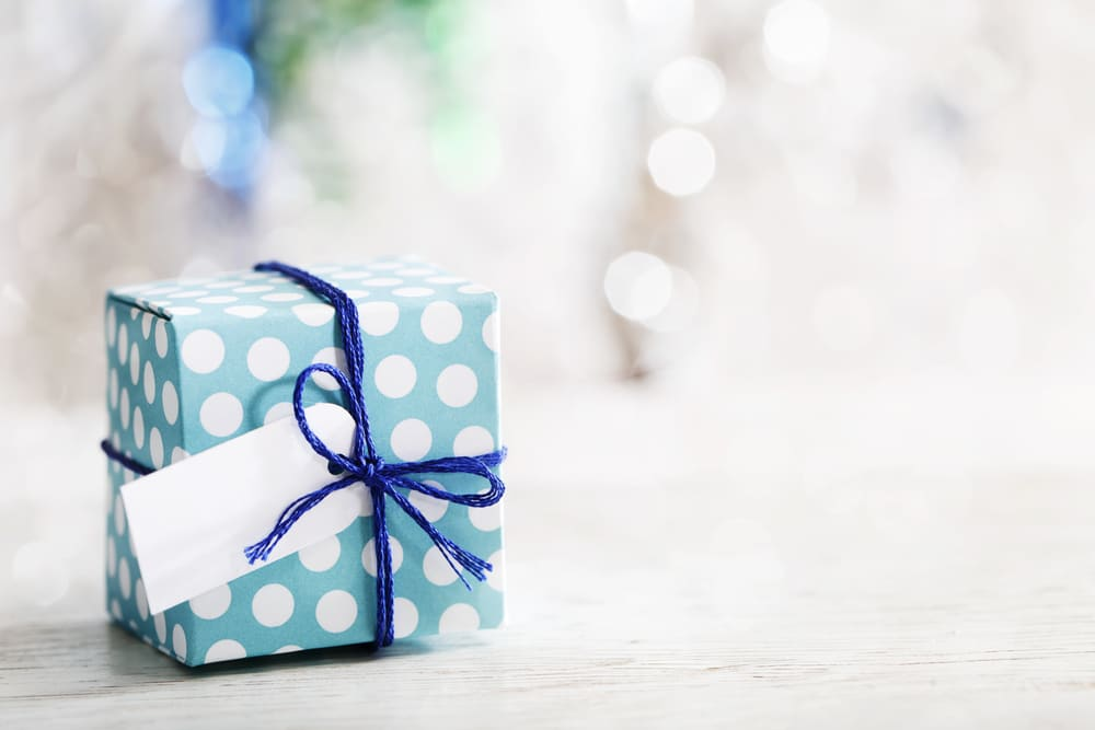 Should my husband still be getting presents with his daughter for his ex?
